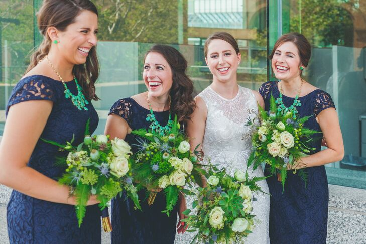 Navy bridesmaid dresses were paired with teal necklaces and green bouquets to bring the palette to life.