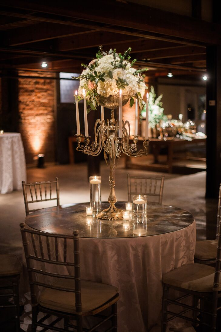 Lane loved the look of towering candelabras, which led them to be featured throughout the ceremony and reception as centerpieces and romantic details.