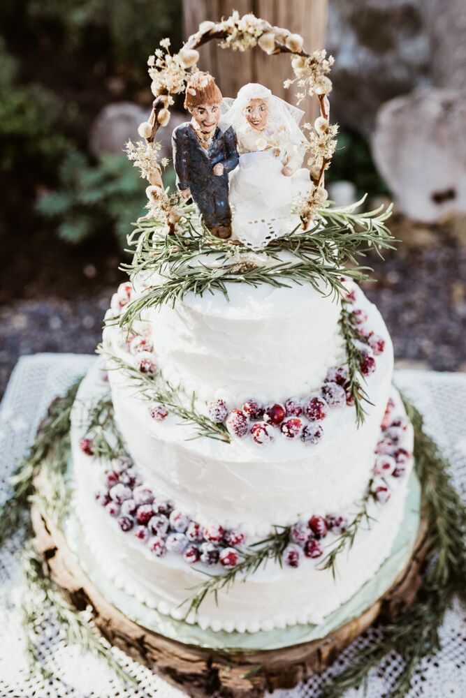 Laura's mother baked the couple's wedding cake, almond flavored with buttercream and sugared cranberries. She also made the clay cake topper (a Laura and Austin look-alike bride and groom).