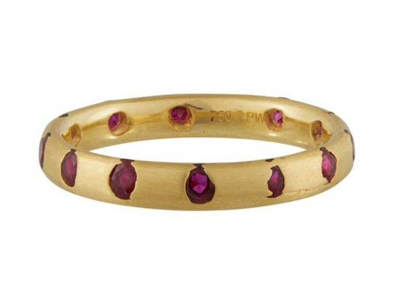Engagement ring with small rubies cast into molten gold band