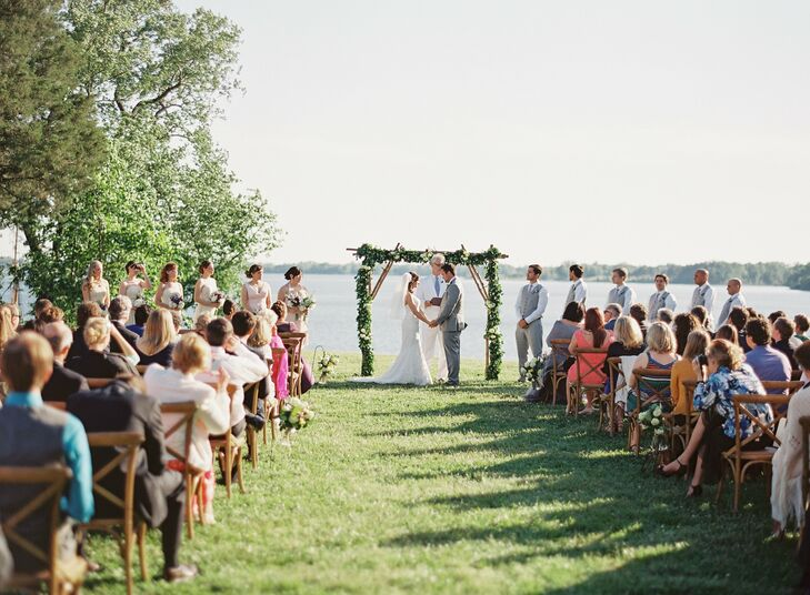 Ayse and Jack exchanged vows under a wooden arch draped with garlands of seasonal greens.