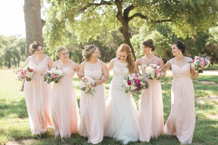 The bridesmaids wore long pink petal dresses in styles they felt most comfortable wearing.