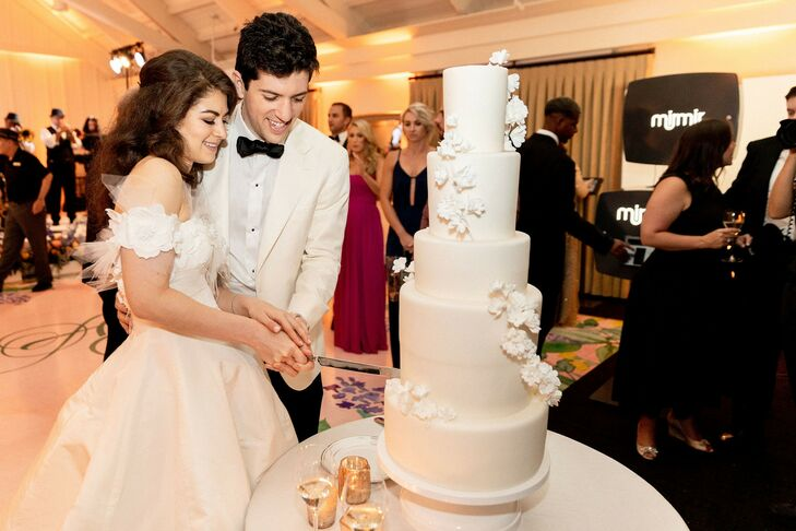 Elegant Tiered Fondant Wedding Cake with Flowers