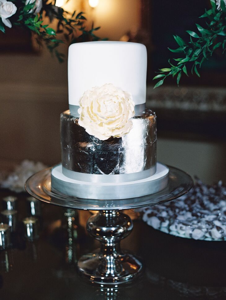 In a nod to the night's metallic accents, the two-tier cake was decorated with shimmering silver leaf.
