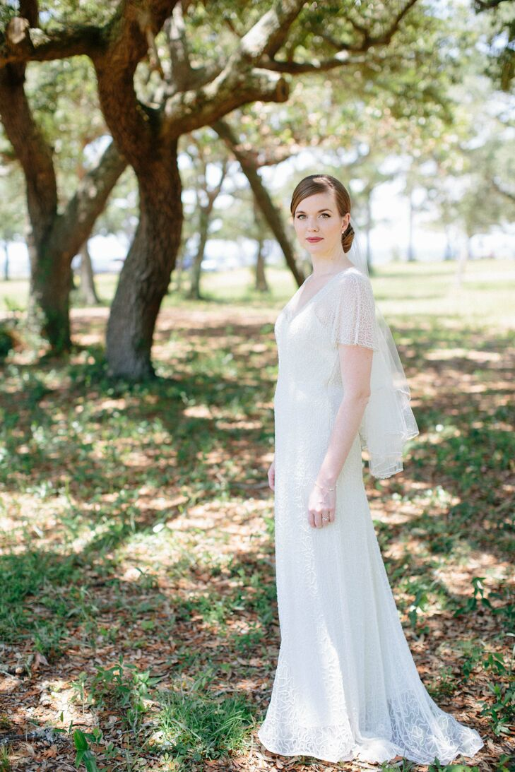 "Deborah's wedding dress is from J.Crew. ""I wanted to wear a simple, classic, elegant dress and one that would be comfortable to be in all day,"" says Deborah."