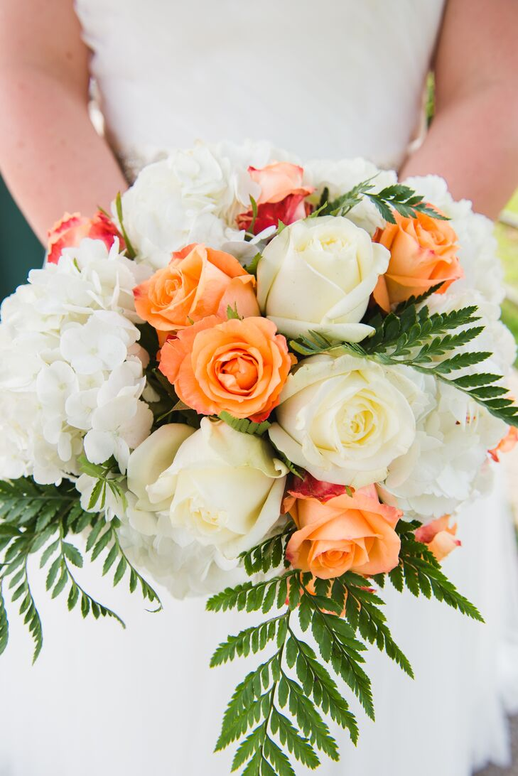 Holly's bouquet had white roses and hydrangeas, complemented by coral roses and green ferns.