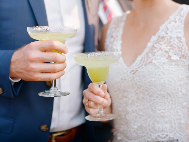 Couple holding margaritas
