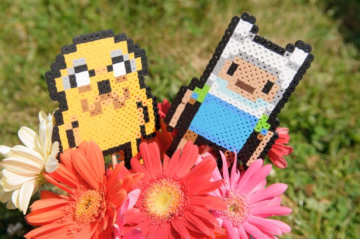 Jake and Finn (from the cartoon Adventure Time) perlers added a geeky touch to the bright coral and pink gerbera daisies on display.