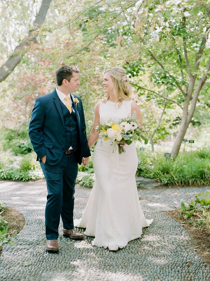Classic Couple with Formfitting Wedding Dress and Blue Suit