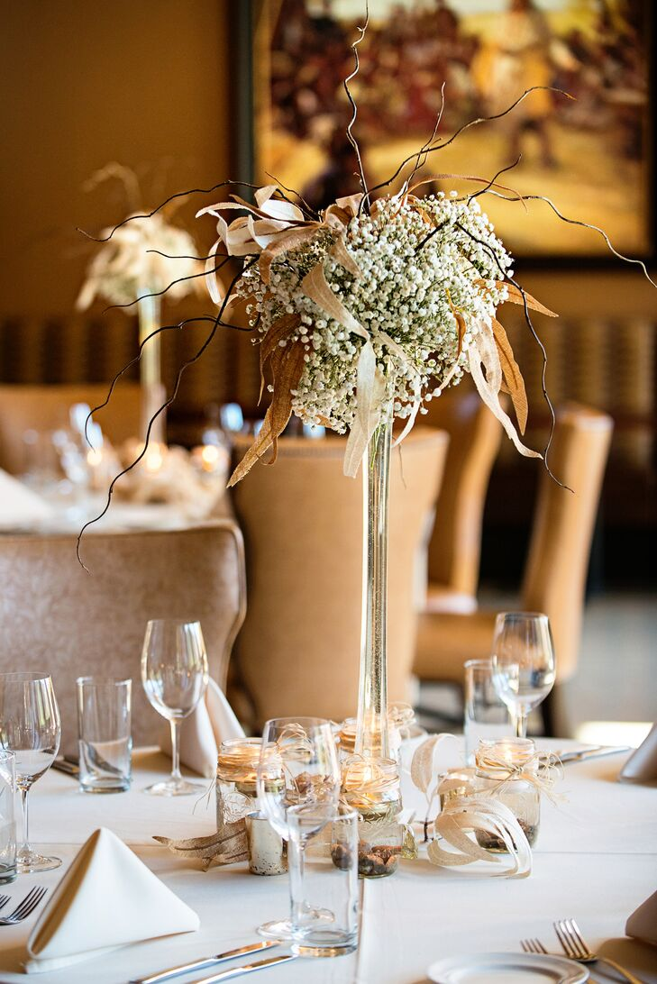 The reception tables were topped with white baby's breath and rustic branches that Crystal found at Michaels. Mason jars wrapped with raffia and filled with floating candles added to the look.