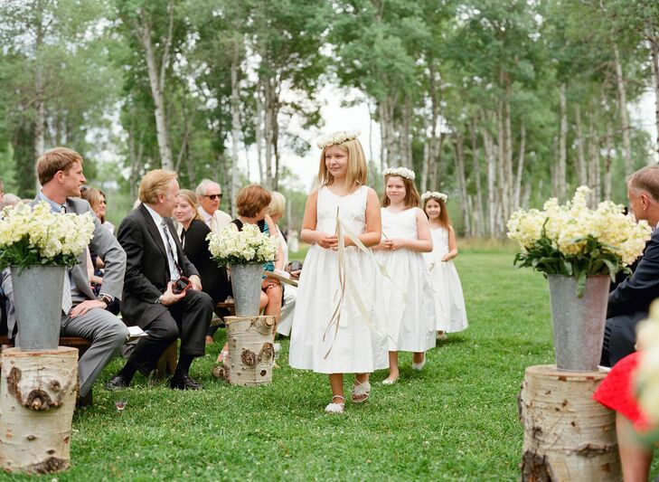 Anna and Alex wanted all of their 10 nieces and nephews involved in the wedding, so they had three flower girls, who all carried ribbon wands down the aisle.