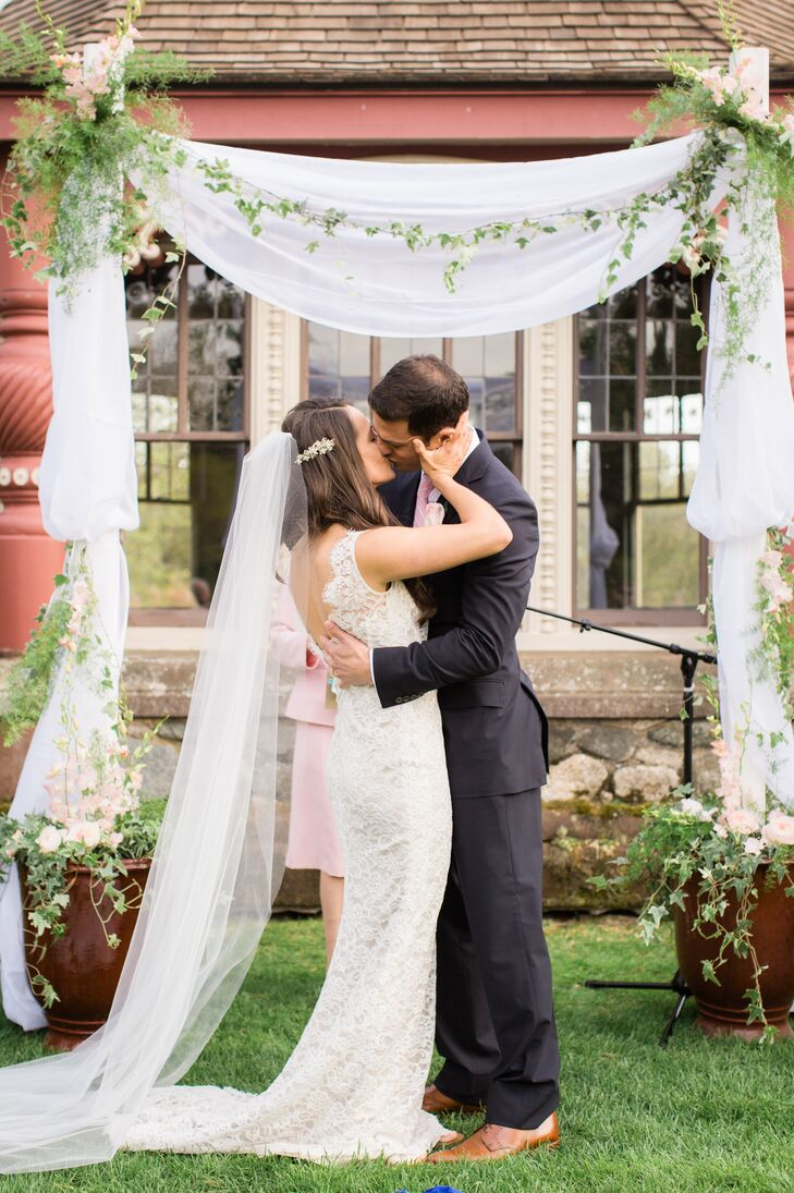 The couple included rituals of Catholicism (a unity candle) and Judaism (the breaking of the glass) in their ceremony.