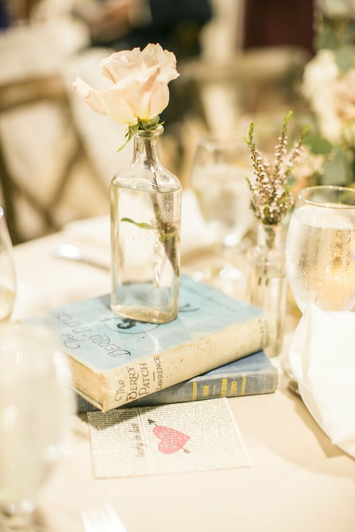The tablescape decor included candles, mason jar vases, simple wildflowers, glass bottle vases and vintage books.