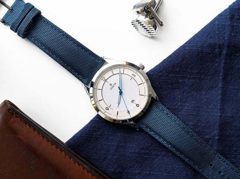 Modern and minimalist navy canvas strap watch with white dial