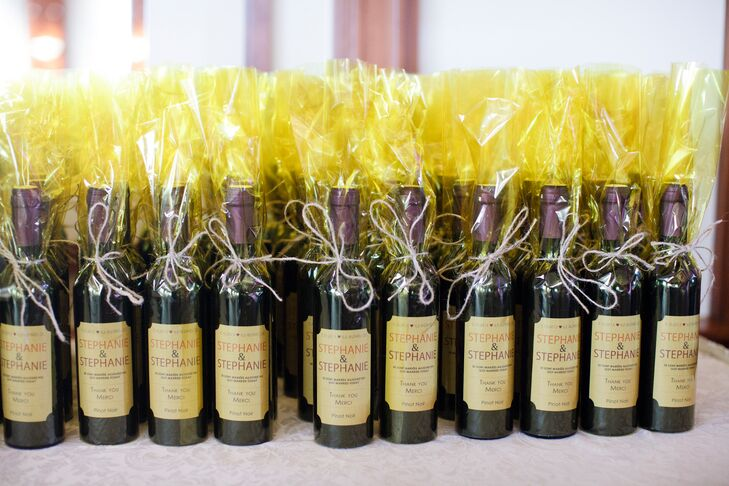Wine bottles were given to guests as favors.
