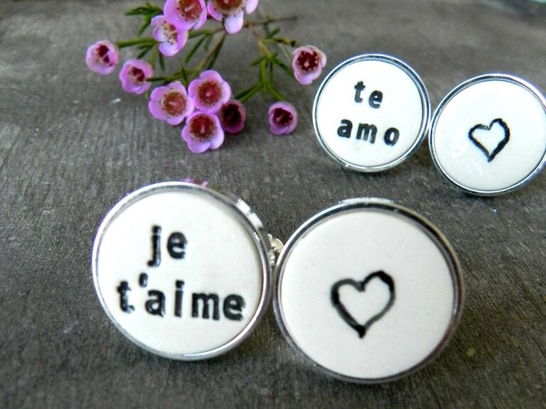 Two sets of white porcelain cuff links with Je t'aime and Te amo