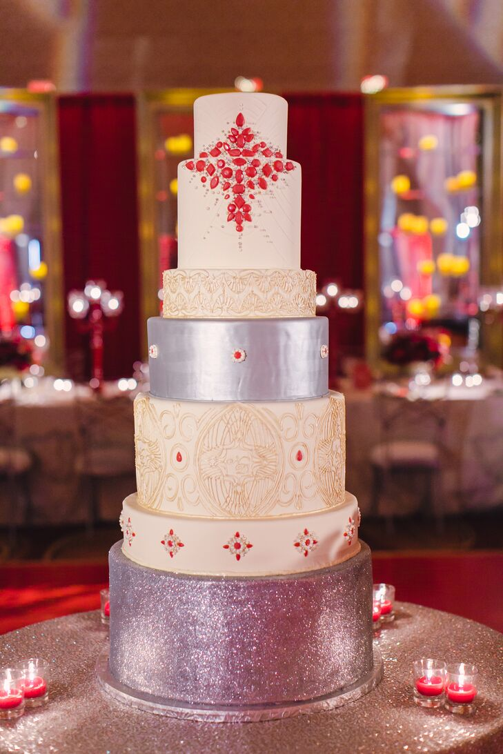 Nicole wanted a big cake. The couple served a beautiful seven-tier creation with a custom design inspired by the stationery.