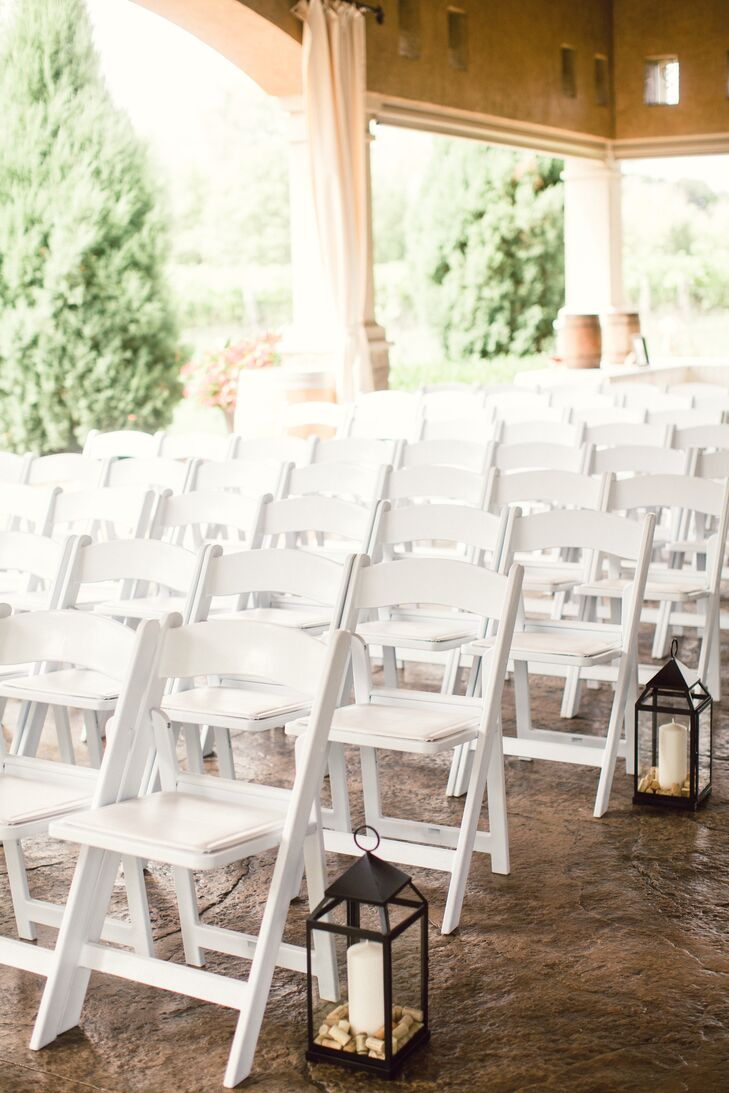 Rows Of White Folding Chairs At Ceremony