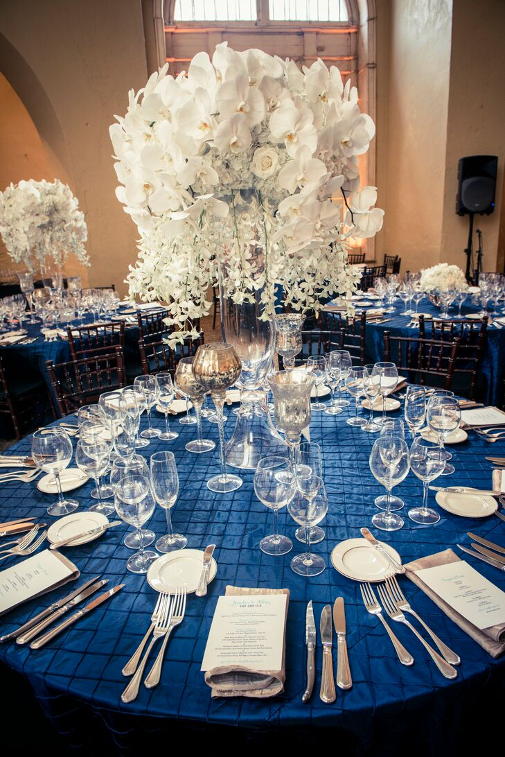 Making things a little more personal, they used Adam's grandmother's love of orchids as the inspiration for their all-white centerpieces. Half the reception tables were paired with tall all-white arrangements of orchids, hydrangeas and roses that cascaded from a tall trumpet vase. Candles in different mercury glass votives also surrounded the centerpieces.