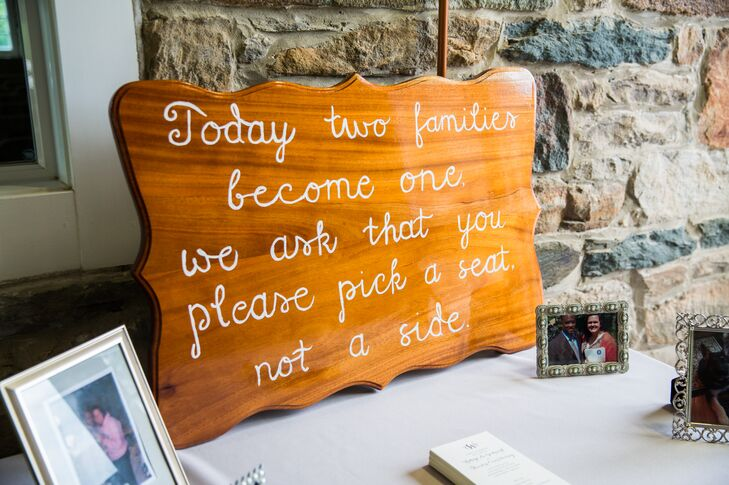 A painted wooden sign at the ceremony let guests know that they could choose their own seating.