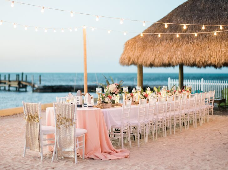 Nicole knew she wanted a single long table and planned accordingly. All 25 guests were able to sit at one table for a family-style meal in the sand under strung twinkling lights.