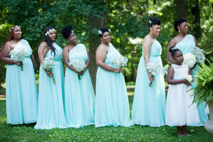 All the bridesmaids sported one-shoulder blue floor-length dresses with a touch of mint incorporated into the color. They stood at the front of the ceremony space as they watched Sicilia and Samuel become married.