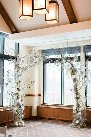 Winter-Themed Wedding Arch with Branches and Snowflakes