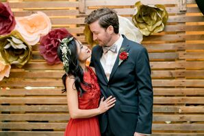 Boho Couple in front of a Paper Flower Garland