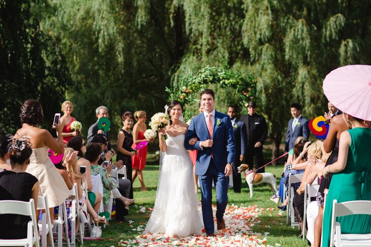 With a stunning natural setting at their disposal, an outdoor ceremony was non-negotiable for Hannah and Ed. The pair gathered guests on the shores of Swan Pond, where they exchanged vows under a lush floral arch set against a backdrop of swaying willow trees. To add a personalized feel to the proceedings, the couple sealed a bottle of Portuguese wine and two love letters in a wooden box, to be opened on their fifth anniversary.