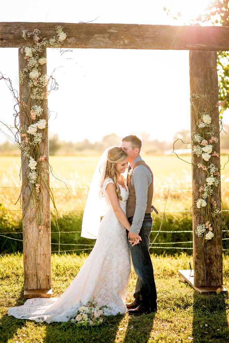 Andrew made the rustic wedding arbor using panels of old barn wood, and Fresh Flower Market attached curly willows, baby's breath, hydrangeas and stock along the sides and in the corner for a stunning ceremony backdrop.