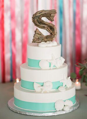 White Fondant Seashell-Decorated Wedding Cake