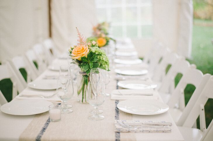 """The color palette was very soft.  The flowers were a mix of white, cream, peach, light green and pale pink,"" says Emily. ""My mom made linen runners for the tables as well as blue and white floral napkins."""