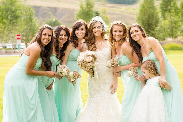 When it came to choosing the bridesmaids' dresses, making sure they were cool and comfortable was key. Melissa chose a strapless, floor-length gown from David's Bridal for all of them to wear, the flowy chiffon fabric making it easy for them to move around, while standing up to the summer heat.