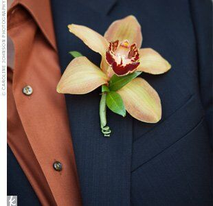 Chad wore a beautiful orange orchid on his lapel.
