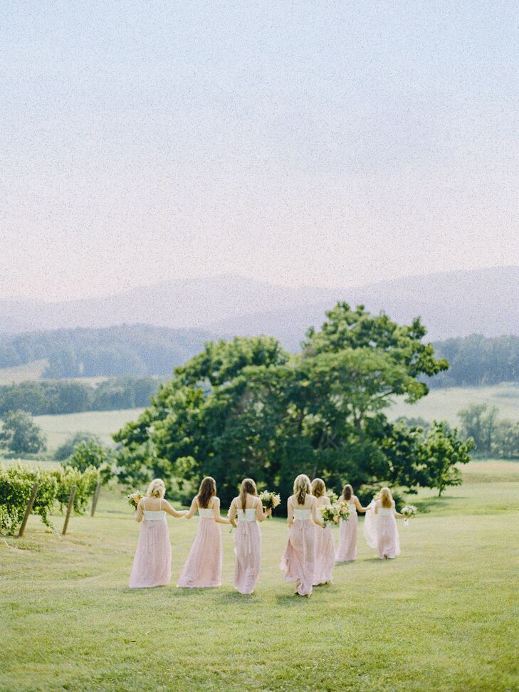 Inspired by her own two-piece style, Augusta dressed her bridesmaids in ivory bustiers and blush wrap skirts.