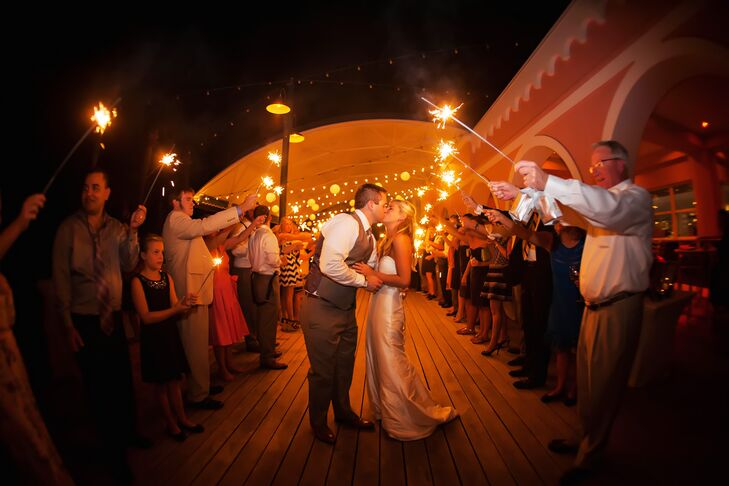 "Kelly and Sam were sent off from their wedding with a canopy of sparklers held by their friends and family. Each sparkler was matched with a ""let love sparkle"" note."