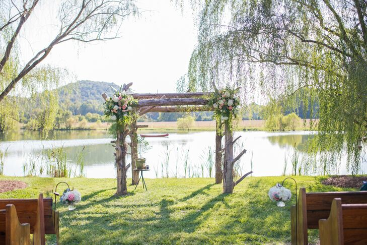 "Morgan and Park exchanged vows under a cedar arch with a lake and mountain backdrop. ""Our ceremony was one of our favorite parts of the day,"" Morgan says. Guests were seated in vintage church pews, and the aisle was lined with mini floral arrangements hanging in glass vases. ""It truly made it feel like an outdoor church,"" Morgan says. ""We chose this location because so many of our adventures have taken place outside while camping, hiking, picnicking and exploring. It is our happy place."""
