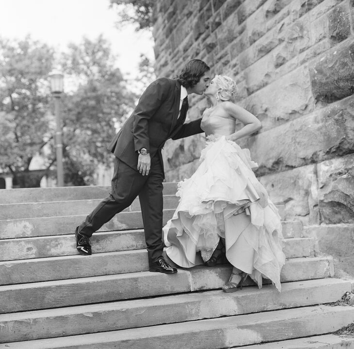Stealing a kiss before joining their guests inside.