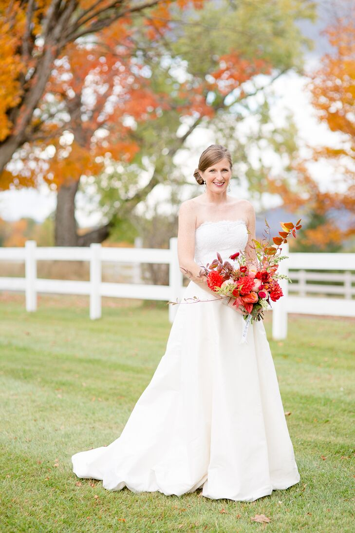 Fall Bride with a Vibrant Red Bouquet