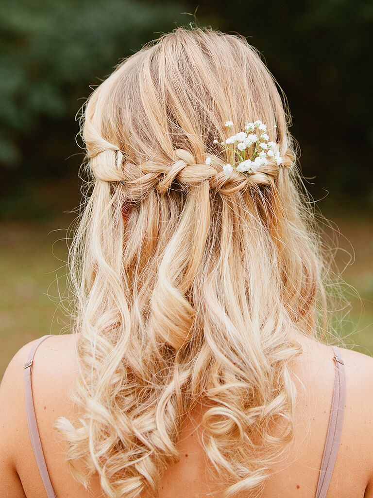 Boho waterfall braid bridesmaid hairstyle with baby's breath