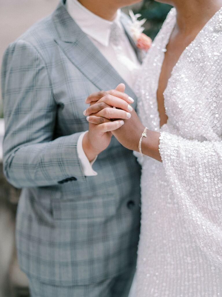 how to choose wedding vendors couple holding hands at wedding