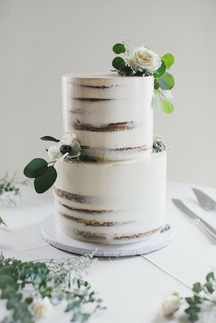 Minimal Semi-Naked Cake with White Icing and Flowers