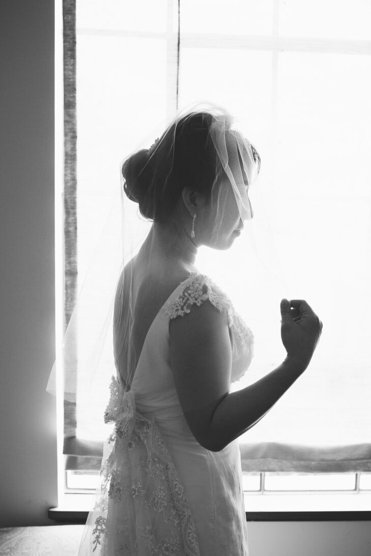 Deborah's dress came from Bel Fiore Bridal, but her mother added touches. She wore a veil from David's Bridal. Her former makeup artist mother also perfected her wedding day look.