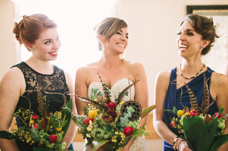 The bride and bridesmaids carried pheasant feathers, billy balls, lotus pods, ranunculus and wildflowers in their organic bouquets.
