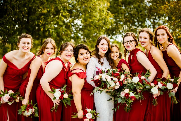 Modern Bridesmaids with Red Gowns and Bouquets