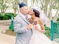 Bride and groom wearing Mickey Mouse ears at Disney-themed wedding