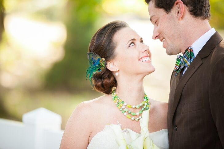 Brittany wore a green necklace and peacock feather to complement all of the casual rustic decor made by their friends and family.