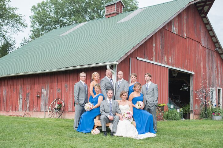 The bridesmaids wore royal blue chiffon gowns, while the groomsmen wore gray suits.
