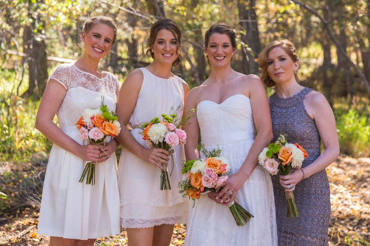 """The bridesmaids wore neutral-colored cocktail dresses of their choice.  """"Everyone's instructions were to just wear something they liked within the color scheme,"""" Abby says."""