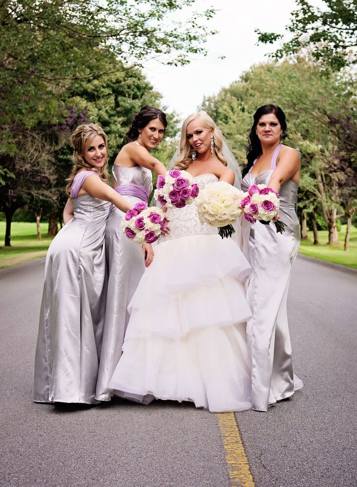 Dayna's bridesmaids wore floor-length silver dresses with lilac sashes to this glamorous wedding.